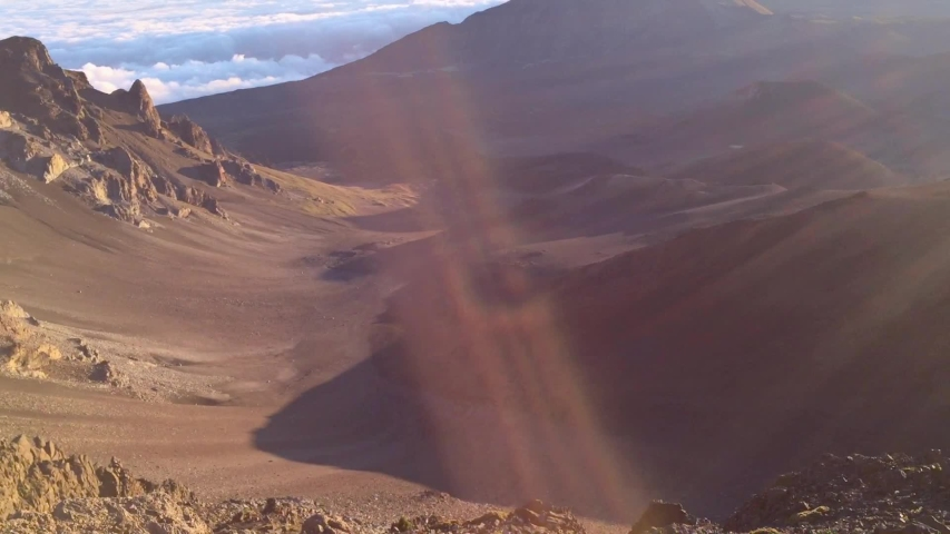 First person view of a pair of sneakers in Haleakala Crater sunrise over the clouds. Sunsrise at 10,000 ft high in Maui, Hawaii. House of the rising sun | Shutterstock HD Video #1035187904