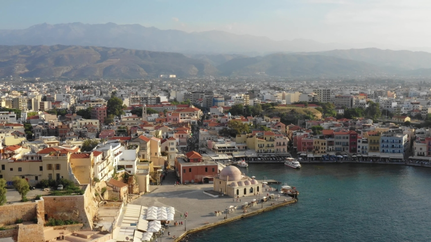 Aerial drone view video of iconic and picturesque Venetian old port of Chania with famous lighthouse and traditional character, Crete island, Greece. Architecture of the Venetian port in Chania. | Shutterstock HD Video #1035430514