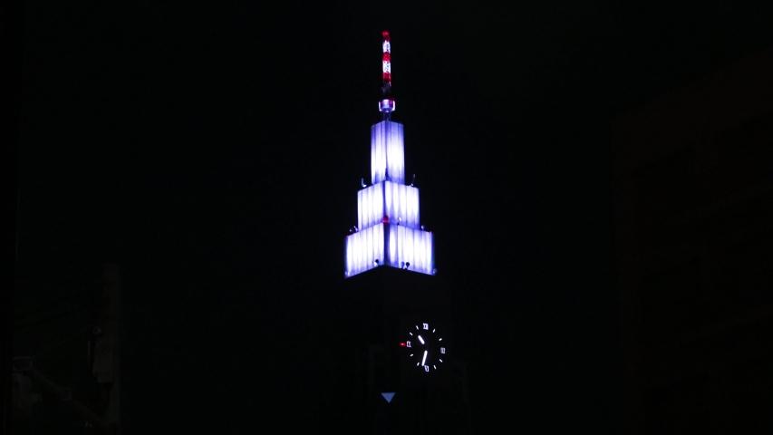 Shibuya , Tokyo / Japan - 06 20 2017: Clock tower on the skycraper at the dark night | Shutterstock HD Video #1035613874