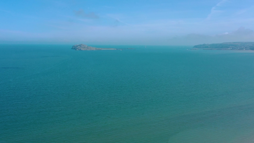View of Ireland's eye island from Portmarnock Beach in Dublin county, Republic of Ireland   Shutterstock HD Video #1035715454