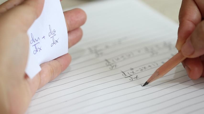 Student Using Formula Math Sheet Stock Footage Video (100% Royalty-free)  1035788534 | Shutterstock
