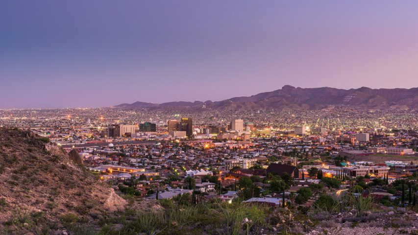 El Paso, Texas, USA downtown city skyline from dusk till night with Ciudad Juarez, Mexico visible in the distance.   Shutterstock HD Video #1035992264