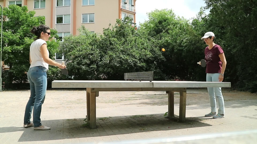 Table tennis or ping pong game on a table in the park of Dusseldorf, Germany | Shutterstock HD Video #1035999914