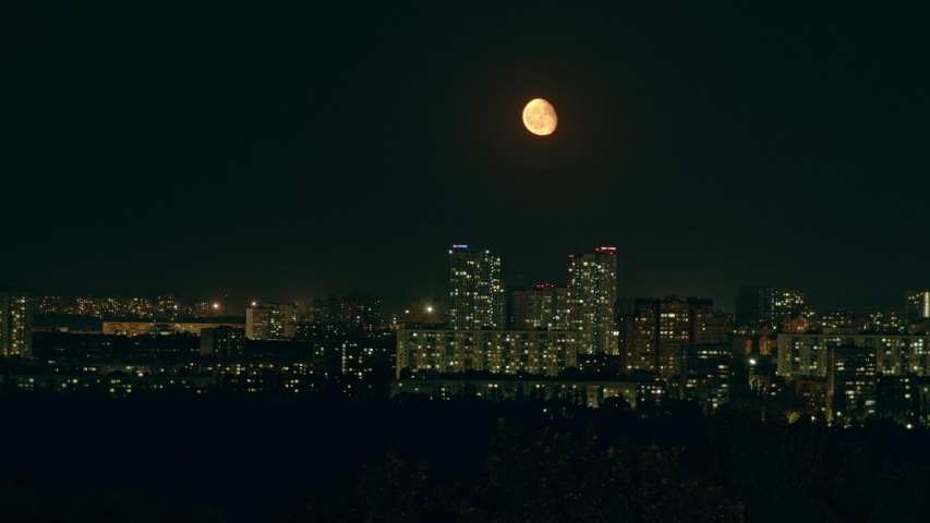 Moon over the night city | Shutterstock HD Video #1036109204