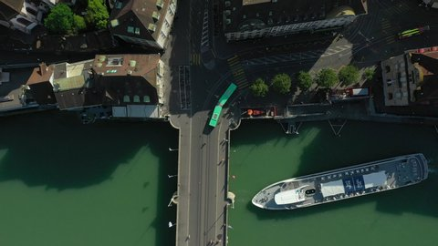 BASEL, SWITZERLAND - JULY 10 2019: summer day flight over basel city river traffic bridge aerial topdown panorama 4k circa july 10 2019 basel, switzerland.