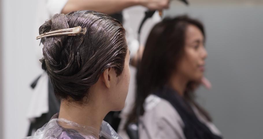 Woman friends go hair salon for treatment together #1036168424