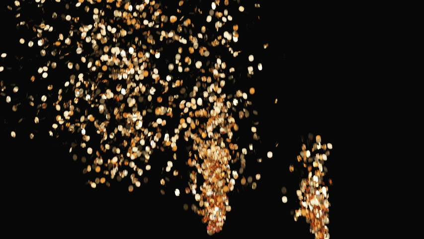 Golden confetti party popper explosions and falling down on the black background  | Shutterstock HD Video #1036182224