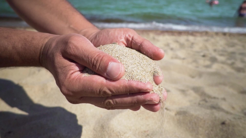 Sand Poured Out of Both Male Hands at the Sea Shore Slow Motion #1036201904