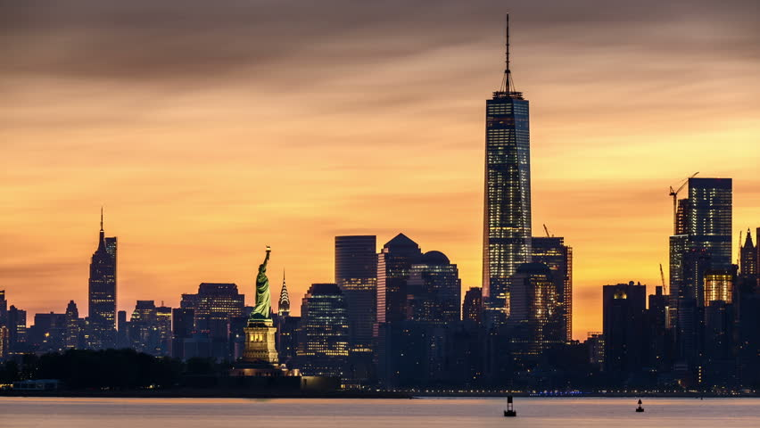 Timelapse with Lower Manhattan, Freedom Tower and The Statue of Liberty at sunrise. For the 4K version check Clip ID 10617296.
