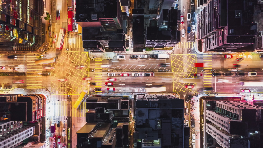 4K UHD Time-lapse of car traffic on road and people crossing street at night in Hong Kong downtown district, drone aerial top view. Commuter, Asia city life, or public transportation concept | Shutterstock HD Video #1036252004