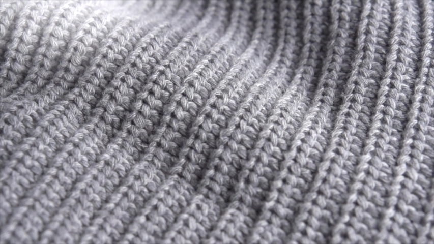 Knitted Wool background. Real Wool clothes texture closeup, dolly shot. Soft grey merino wool macro shoot. Woolen fabric. Knitted texture fabric. 4K UHD video | Shutterstock HD Video #1036382444