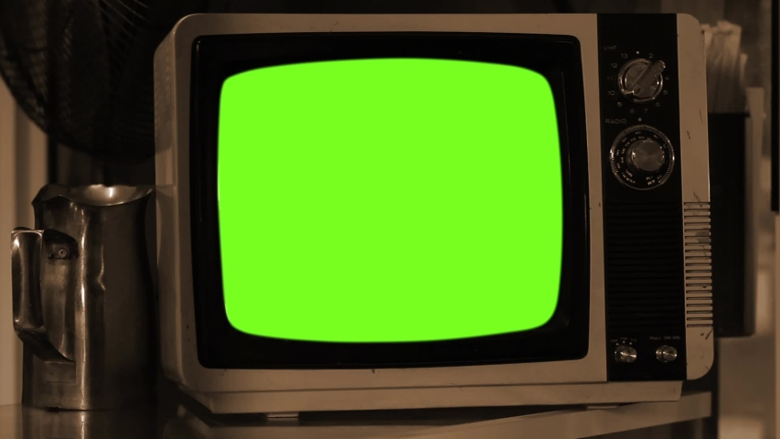 Old Fashioned TV Turns On with Green Screen. Sepia Tone. Zoom In.   Shutterstock HD Video #1036410434