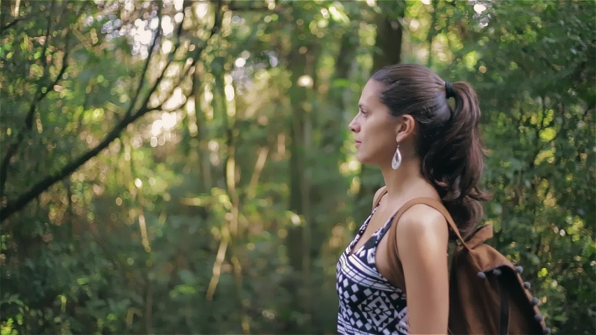 Hiking woman walk in rainforest jungle. side view of girl hiker walking with backpack through rain forest nature on brazil, bokeh effect summer day sun effect. | Shutterstock HD Video #1036688444