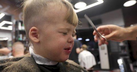 Cute Boy Makes A Haircut In Barbershop