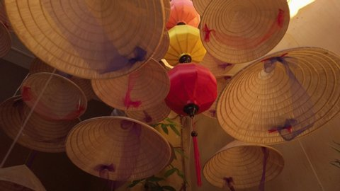 Low Angle View, Conical hat hanging. Asiatic hat exterior hat decoration. Looking around Shop decoration ideas.