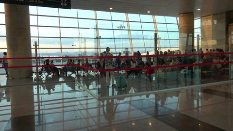Esenboga Airport, Ankara, Turkey - 3d of August 2019: 4K Group of passengers wait for boarding in the airport lounge
