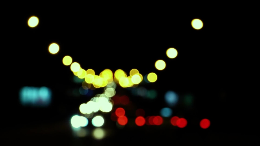Blurred car lights at the crossroads of the big night city   Shutterstock HD Video #1036901204