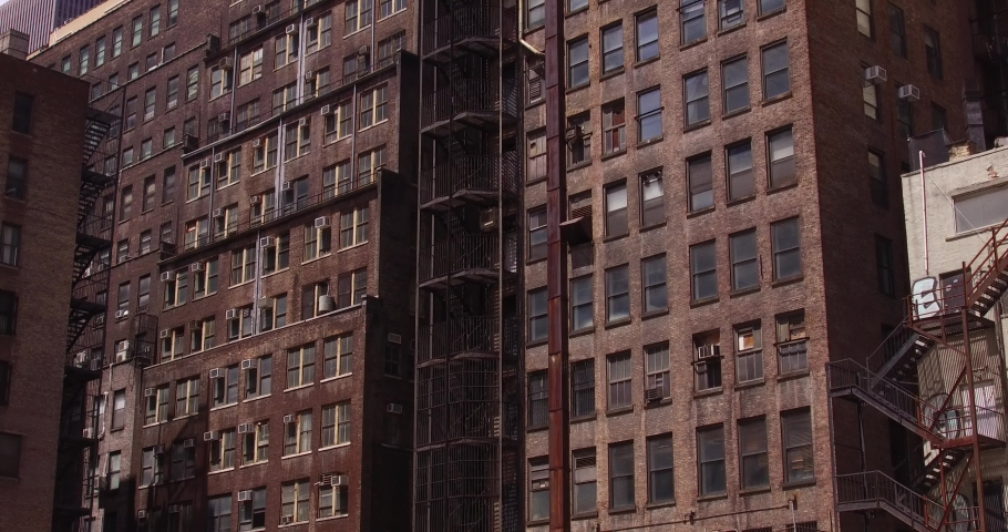 Tilt up shot of an fire escape in the Midtown Manhattan, New York. | Shutterstock HD Video #1036942874