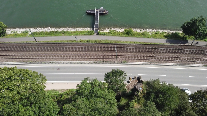 Aerial view on traffic federal road no. 9, river rhine and train tracks with cars passing | Shutterstock HD Video #1037090954