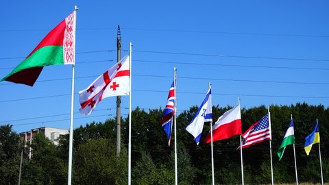 Flags of Belarus, Georgia, Great Britain, Israel, Poland, USA, Uzbekistan and Ukraine on flagpoles.