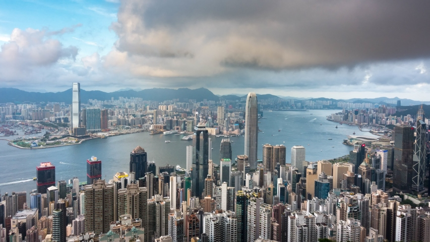 Day to night time lapse of Hong Kong cityscape aerial view from Victoria peak on high mountain, famous landmark for travel in Hong Kong city at sunset time with light show on skyline | Shutterstock HD Video #1037200274
