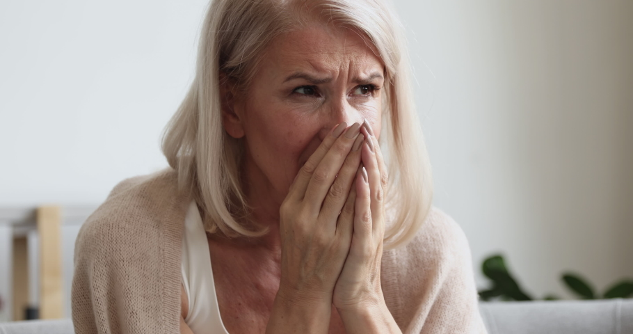 Upset depressed mature old woman crying alone at home thinking of loneliness or grief, sad middle aged senior woman in tears worried about health problems mourning feeling lonely miserable concept | Shutterstock HD Video #1037252564