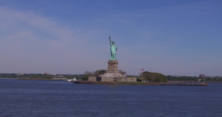 Statue of Liberty National Monument on the Liberty Island in the Upper New York Bay. | Shutterstock HD Video #1037285294