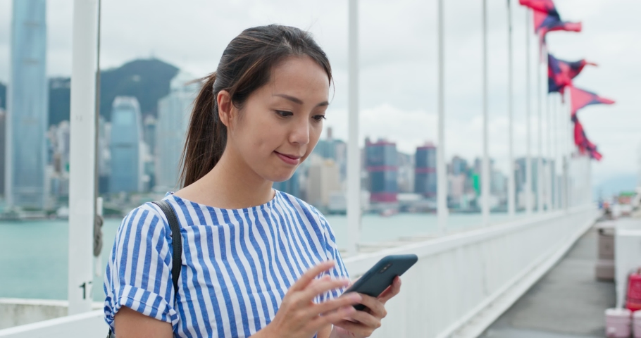 Woman use of mobile phone in Hong Kong | Shutterstock HD Video #1037289824