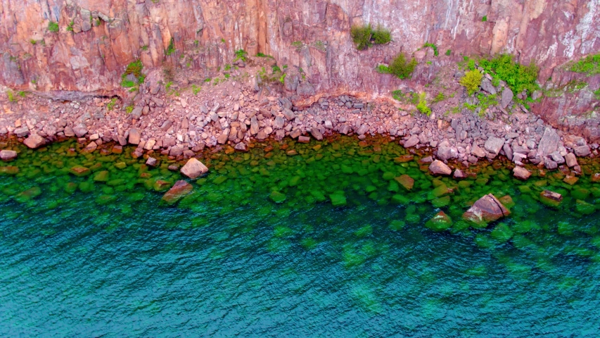 Colorful Rocks in Water, Rocky Cliff, Aerial Drone 4K | Shutterstock HD Video #1037304854