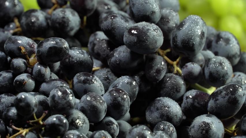 Black grapes rotation background. Grape close up