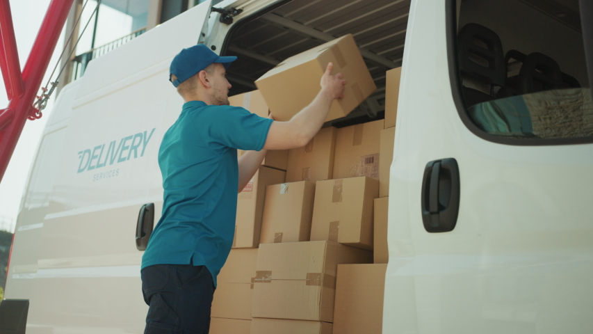 Courier Opens Delivery Van Side Door and Takes out Cardboard Box Package, Closes the Door and Goes on Delivering Postal Parcel. Slow Motion Low Angle | Shutterstock HD Video #1037351354