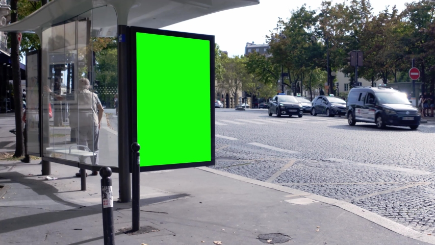 Green screen on a bus stop in an downtown area | Shutterstock HD Video #1037657504