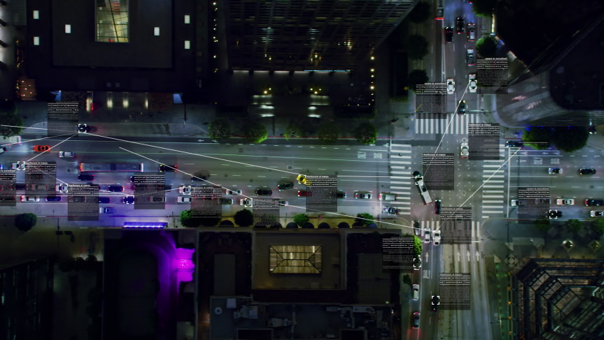 Surveillance system. Aerial view of a crowded downtown avenue. Text and connections displaying in several cars and trucks.  Future transportation. Internet of things. Artificial intelligence. | Shutterstock HD Video #1037664074