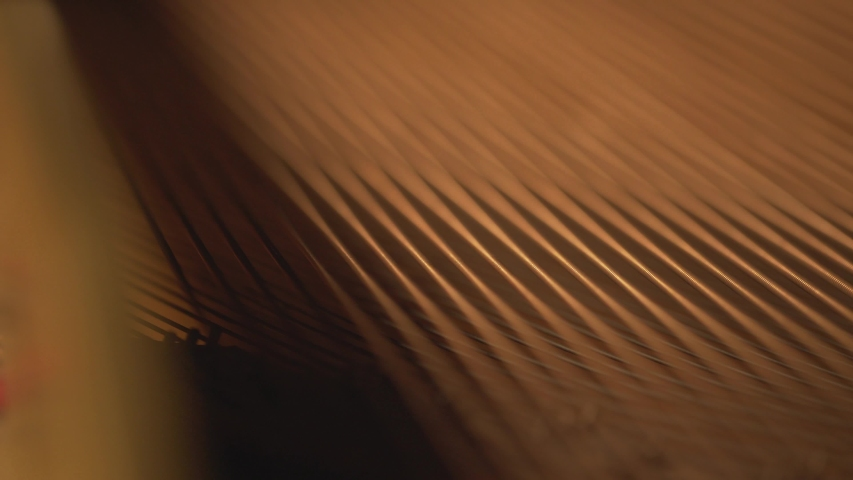 Close up detail of piano strings and hammers , abstract music video artistic footage music instrument | Shutterstock HD Video #1037907464