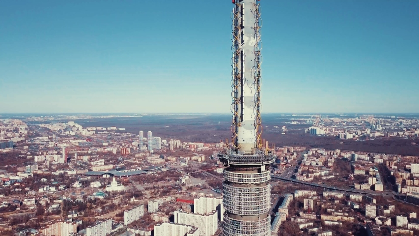 The top with the antenna of the Ostankino television tower in Moscow. Spring city panorama | Shutterstock HD Video #1037996084