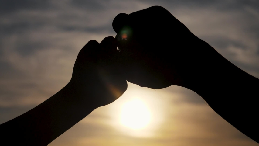 Teamwork concept. of a human hand with lifestyle bumping fist. Friends Friendship Fist Bump Togetherness Concept. father and son teamwork hands silhouette at sunset | Shutterstock HD Video #1038299984