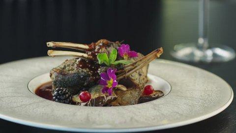 Chef Garnish Fried Beef Ribs in Luxury Restaurant. Shot on RED Cinema Camera in 4K (UHD).