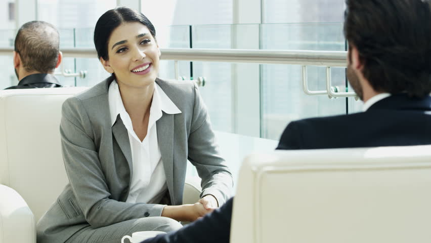 handshake female Western Caucasian male business travel banking finance trader