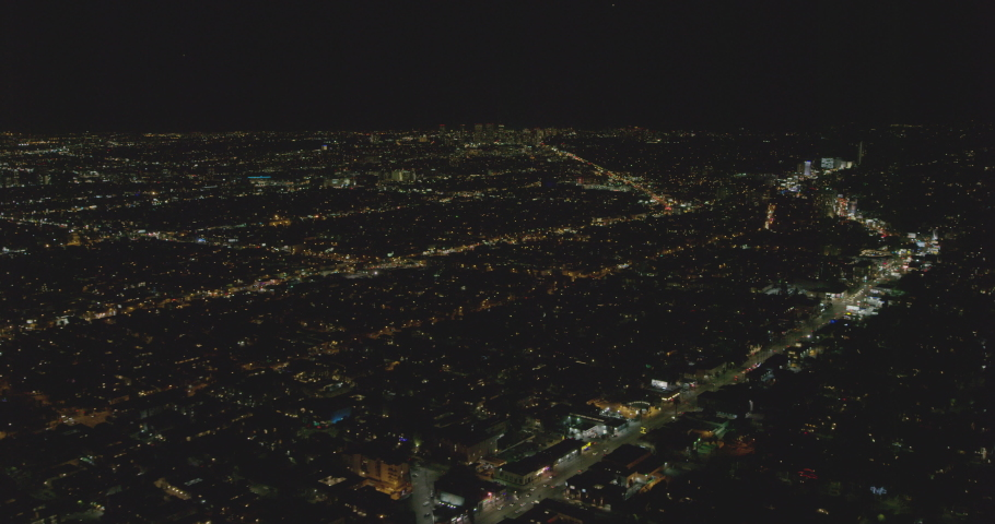 Aerial shot, night, Los Angeles, neighborhoods with business buildings in background, drone | Shutterstock HD Video #1038529214
