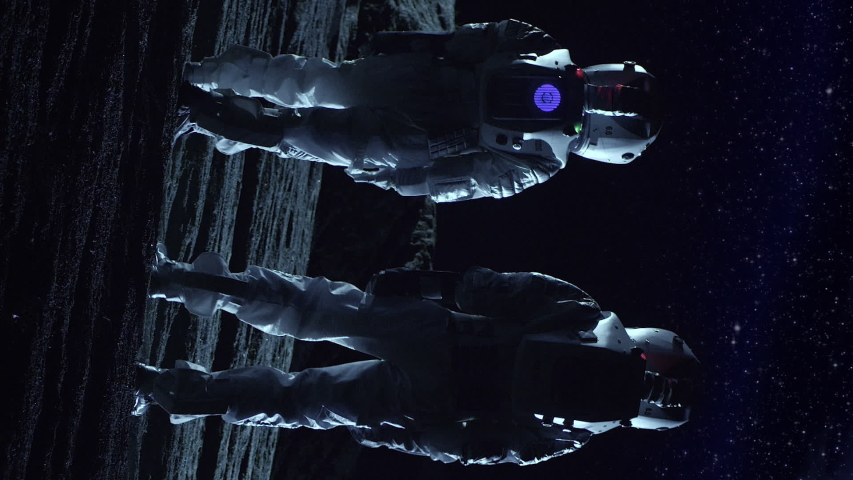 Two Astronauts in Space Suits Standing on the Alien Planet Look at Dark Sky. Space Travel, Habitable World and Colonization Concept. Video Footage with Vertical Screen Orientation 9:16   Shutterstock HD Video #1038600374