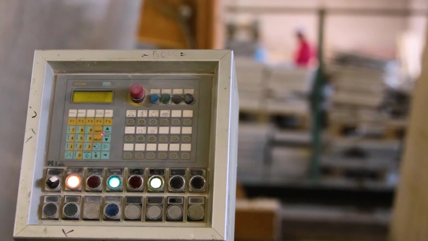 Close up of control panel of heavy machinery inside a stone tile manufacturing plant | Shutterstock HD Video #1038713474