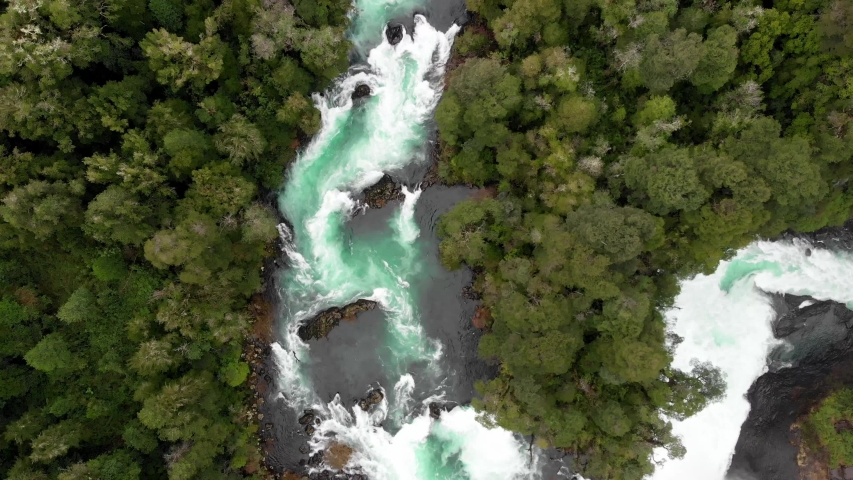 Aerial view of Huilo Huilo river near to the waterfalls in southern Chile | Shutterstock HD Video #1038726974