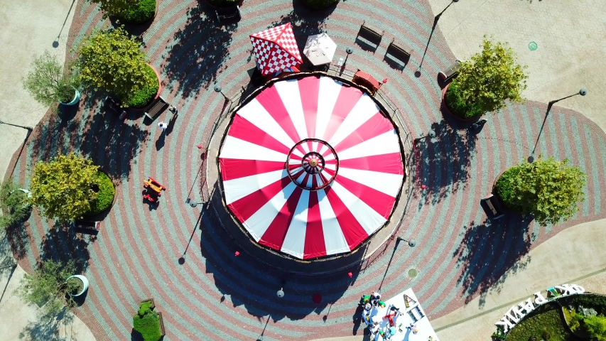 Aerial view of red and white spinning carousel at Moscow | Shutterstock HD Video #1038777614