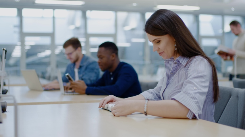 Multicultural group of students studying in a public library | Shutterstock HD Video #1038802604