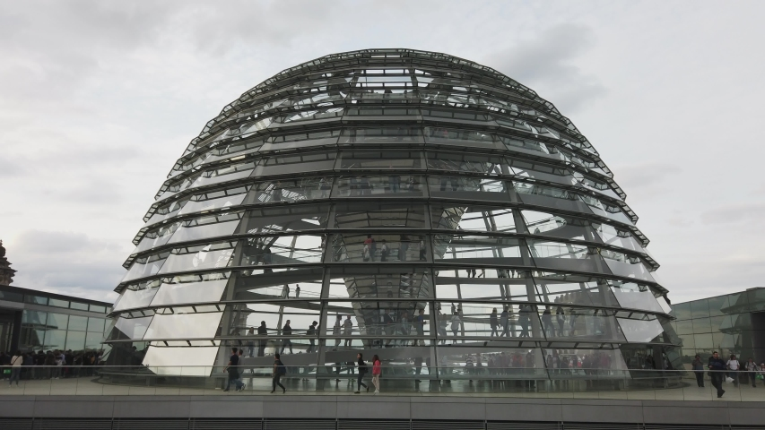 Berlin, Berlin / Germany - September 8 2018: Bundestag in Berlin Germany on the roof glass dome. People walking inside the dome at the doors open day.
