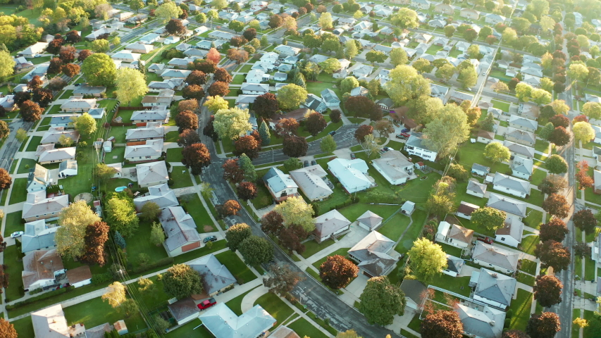 Aerial view of residential houses at autumn (october). American neighborhood, suburb. Real estate, drone shots, sunset, sunny morning,  sunlight, from above | Shutterstock HD Video #1039007924