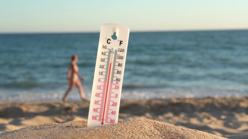 Thermometer for the temperature on the beach, in the summer in the heat. Global warming. | Shutterstock HD Video #1039093274