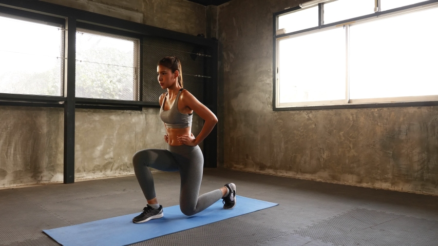 Sporty woman exercising building muscles at the gym #1039182494