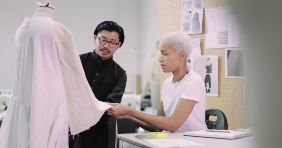 Fashion student with tutor at college | Shutterstock HD Video #1039186004