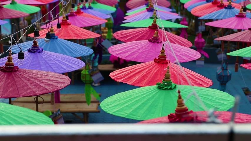 Umbrellas made of colorful fabrics, Thai crafts Lanna umbrella,Chiang Mai Thailand. | Shutterstock HD Video #1039281374
